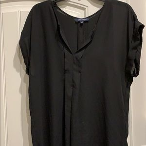 Comfortable blouse with pleat in center back.